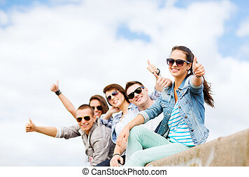 teenagers showing thumbs up - summer holidays and teenage...