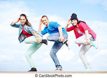 group of teenagers dancing - sport, dancing and urban...
