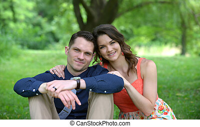 Couple sitting in garden setting