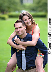 Young man carrying his fiance - Handsome young man carrying...