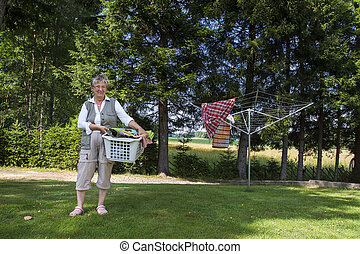 Old woman with laundry basket