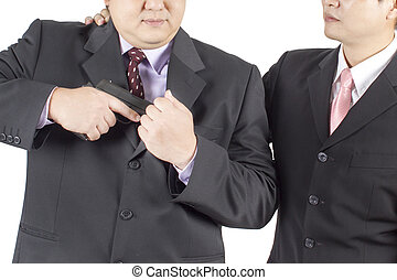 one caucasian businessman with gun ready to shooting in silhouette studio isolated on white background