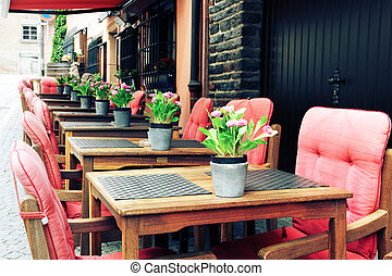 Cafe terrace in European city - Cafe terrace in small...