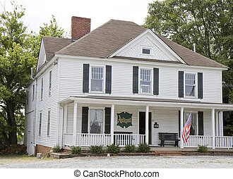 Antique House - An old white colonial house used as an...