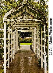 Arbor Into Rose Garden - A wooden arbor leading into a rose...