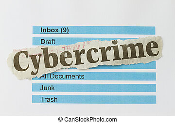 Cybercrime newspaper cutout over an email inbox abstract