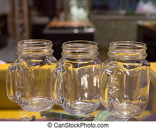 Clear Glass Mugs on Yellow Bar