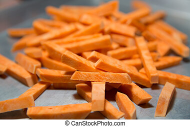 Fresh Raw Hand Cut Sweet Potato Fries on Stainless Steel Pan