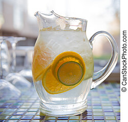 Glass Pitcher of Water With Fresh Lemon and Lime Slices -...