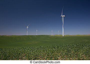 White Wind Turbines Over Rolling Green Hills - White Wind...
