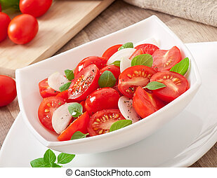 tomato cherry salad with basil, black pepper and onion