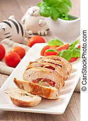 Grilled chicken breast stuffed with basil, tomato and garlic