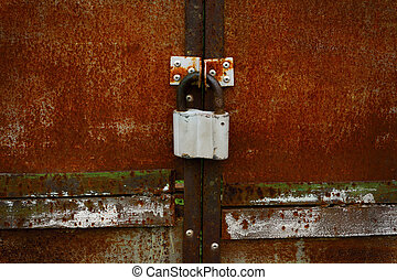 Rusty closed doors with old fashioned padlock