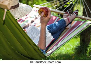 Snack on hammock - A reader having a snack on a hammock