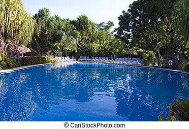 Blue Pool and Blue Chairs - Blue swimming pool and blue...
