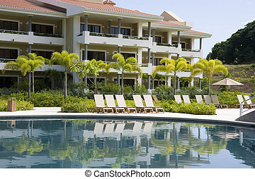 Blue Pool by Resort - A nice blue swimming pool by a tropica...