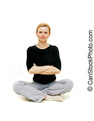 young woman sitting with her arms crossed
