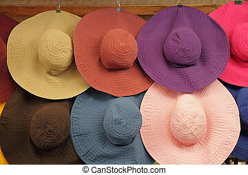 colorful summer woman sun hats on market in Florence, Italy,...