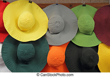 colorful woman sun hats in shop window, Florence, Italy,...