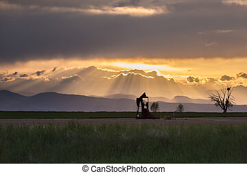 Front Range Pumpjack With Crepuscular Rays - Pumpjack and...