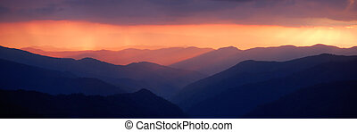 Bright sunset - Majestic mountain panorama with enchanting...