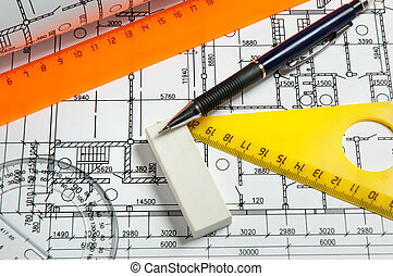 rulers and plans engineering drawing on drawing desk with...