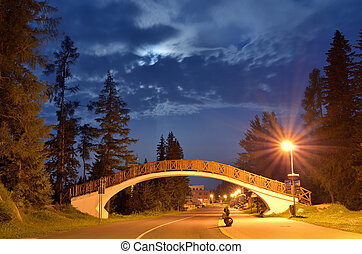 Road to the pedestrian bridge at the resort Strbske Pleso -...