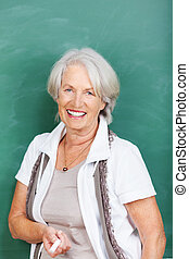 Studying in your retirement - a happy relaxed senior woman...