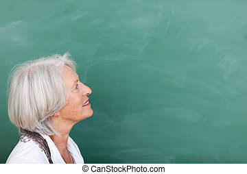 Education in old age - an elderly woman continuing her...