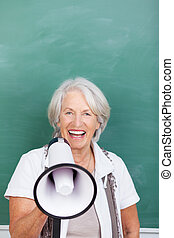 Laughing senior woman with a megaphone