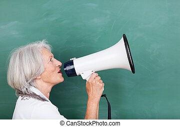 Senior woman with a megaphone