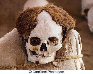 Mummy in Chauchilla archeological site near Nazca (Peru)
