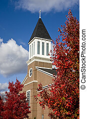 Brick Church in Autumn - A modern brick church with autumn...