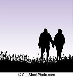 A man and woman walking in a field