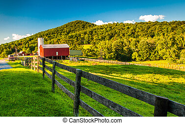 Barn and fields on a farm in the Shenandoah Valley,...