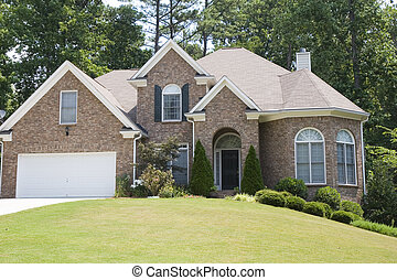 Brick House Conical Firs - A nice brick house with fir trees...