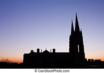 Catholic cathedral silhouette at dawn