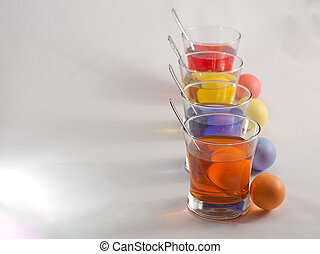 Clear Glasses Filled With Red, Orange, Blue and Yellow...