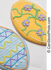 Easter Cookies in the Shape of an Egg Decorated with Blue...