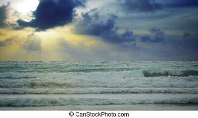 Sky with solar beams over sea
