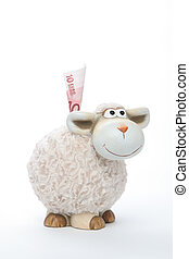 Sheep coin bank with euro on white background
