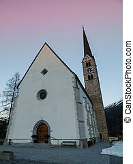 Scuol church in winter time evening (Switzerland)