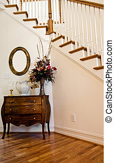 Foyer by Stairs - A nice foyer by interior stairs with table...
