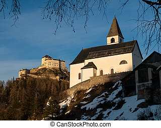 Tarasp castle and church near Scuol (Switzerland)