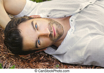 Beautiful man face - Portrait of young man outdoors with...