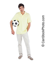 Young man holding soccer ball