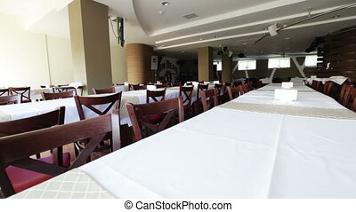 Tables with tablecloths - Banquet tables, covered with white...