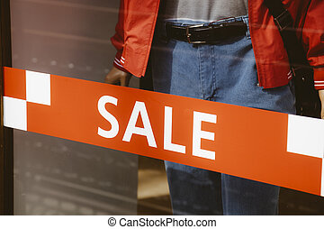 season sale - shopping sale with red notice on the window,...