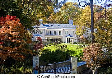 Grey Brick Mansion on Hill - A gray brick mansion on a...