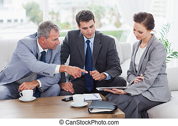 Work team having a meeting together in bright office